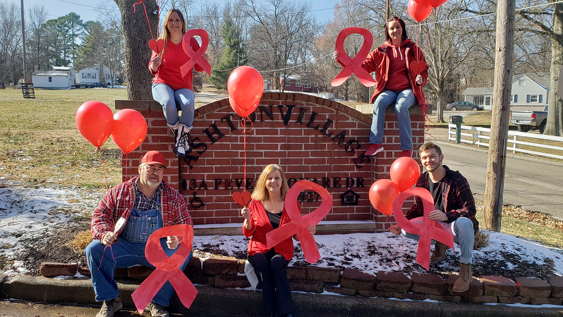 The Ashton Village Team Shows Their Support Of National Heart Month With Their Red Attire And Décor.